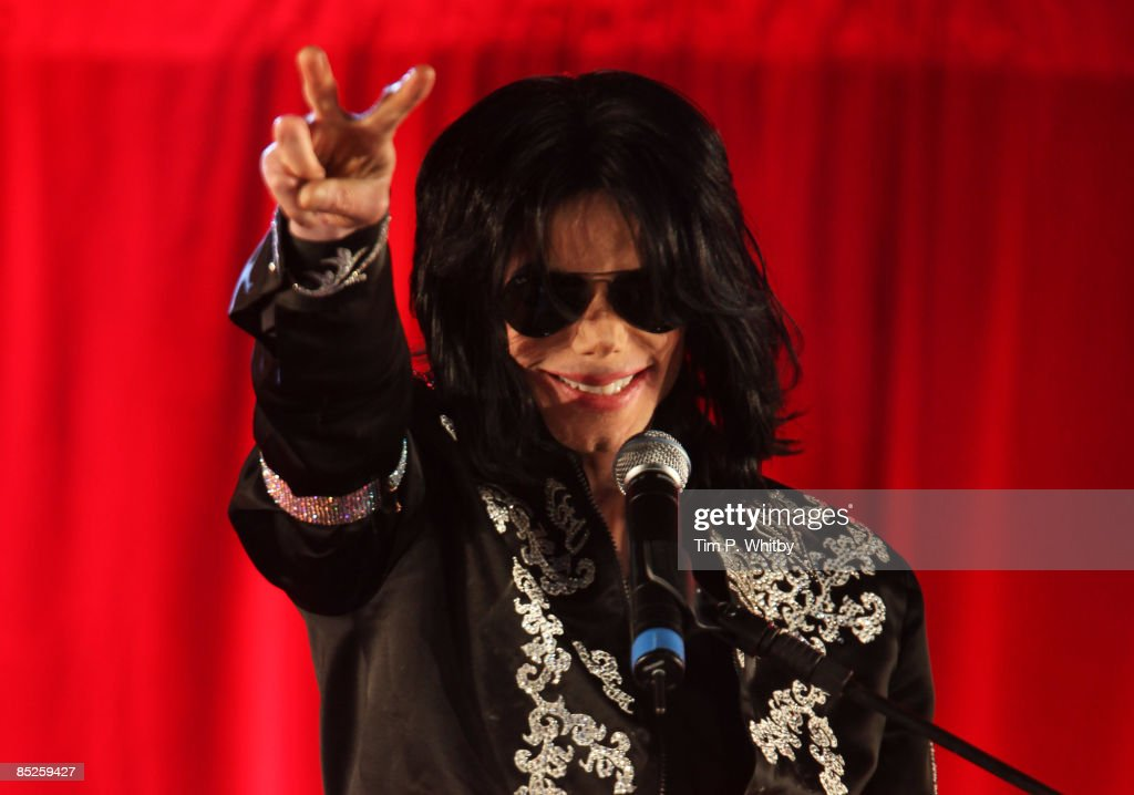 Michael Jackson gestures as he announces plans for Summer residency at the O2 Arena at a press conference held at the O2 Arena on March 5, 2009 in London, England.