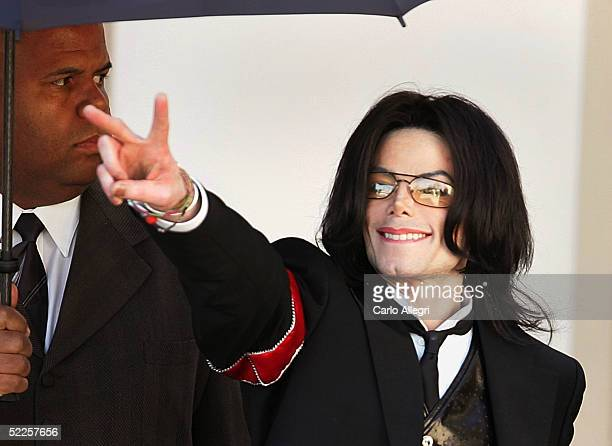 Michael Jackson gestures to fans as he departs the first day of opening statements in his child molestation trial February 28 2005 in Santa Maria...