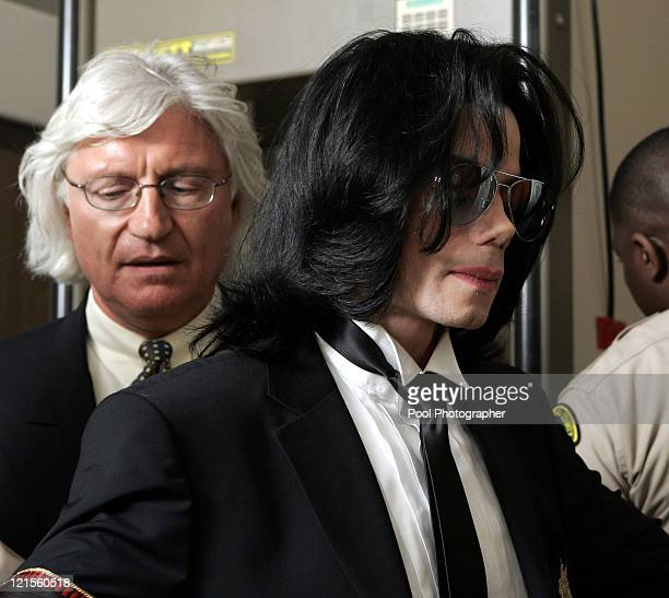 Michael Jackson goes through security as he prepares to enter Santa Barbara County Superior Court in Santa Maria Calif with his attorney Thomas...