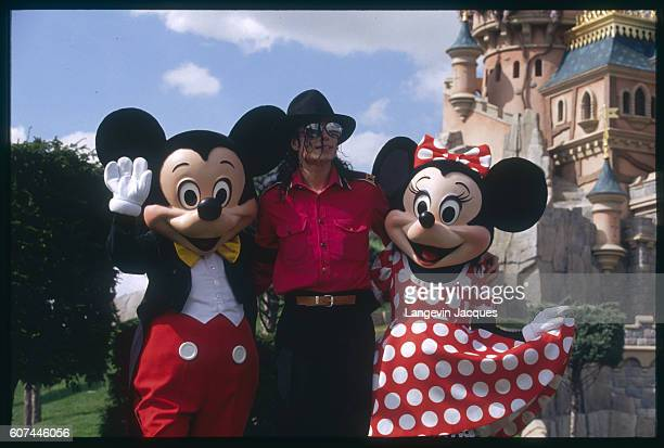 Michael Jackson has his photo taken with Mickey and Minnie Mouse at Disneyland Paris For his visit Jackson had the park closed to the public so he...