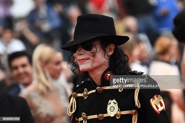 A Michael Jackson impersonator arrives on May 15 2018 for the screening of the film 'Solo A Star Wars Story' at the 71st edition of the Cannes Film...