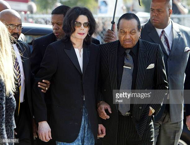 Michael Jackson is escorted into the court house by his father Joseph Jackson after arriving late for his child molestation trial at Santa Barbara...
