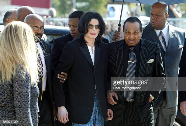 Michael Jackson is escorted into the court house by his security and father Joe Jackson after arriving late at Santa Barbara County Superior Court on...