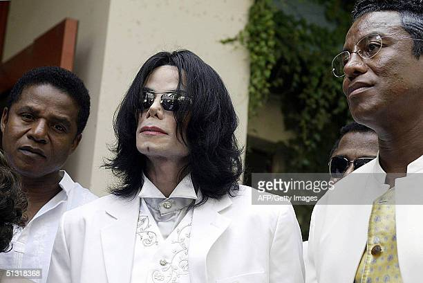 Michael Jackson is flanked by his brothers Jermaine and Randy after leaving the morning session of a pretrial hearing in his child molestation case...