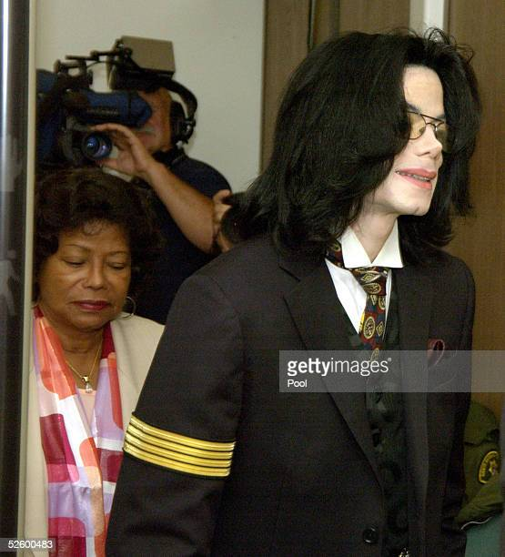 Michael Jackson is followed by his mother Katherine as they return to the courtroom April 7 2005 after a break in his child molestation trial in...