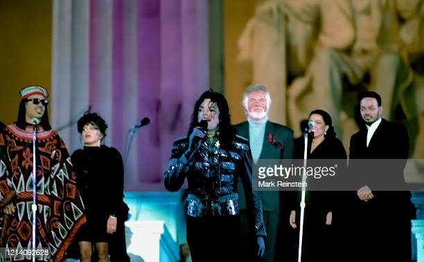 Michael Jackson Kenny Rogers Diana Ross and Stevie Wonder wait on stage at the Lincoln Memorial Inaugural gala for President William Clinton and...
