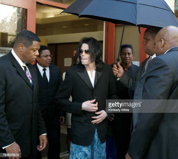 Michael Jackson leaves a court house wearing pajama bottoms for his child molestation trial in Santa Maria California