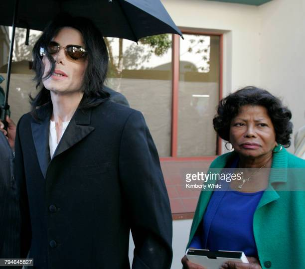 Michael Jackson leaves a court house wearing pajama bottoms for his child molestation trial next to his mother Katherine in Santa Maria California