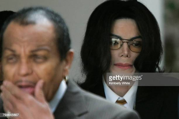 Michael Jackson leaves at a court house with his father Joseph during his trial for child molestation in Santa Maria California