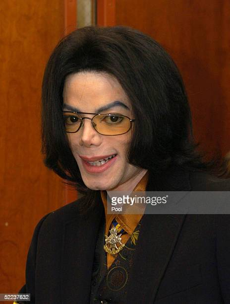 Michael Jackson leaves court after jury selection in his child molestation trial February 24 2005 in Santa Maria California Along with the main jury...