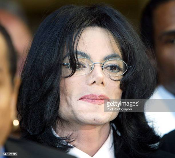 Michael Jackson leaves during his indictment on charges related to child molestation at the courthouse in Santa Maria Calif Friday April 30 2004 pool...