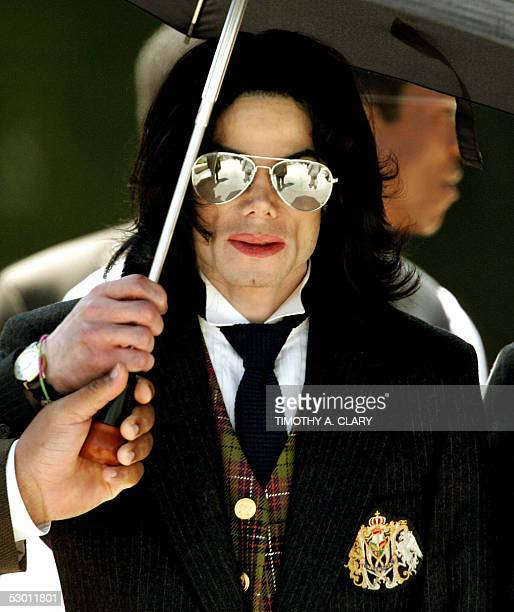 Michael Jackson leaves the Santa Barbara County courthouse 02 June 2005 in Santa Maria California Jackson is charged in a 10count indictment with...