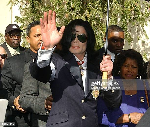 Michael Jackson leaves the Santa Maria Courthouse with his mother and sister Janet Jackson Friday Jan 16 2004