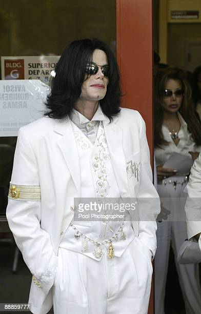 Michael Jackson listens to his attorney Thomas Mesereau Jr speak to the media at the Santa Barbara Courthouse in Santa Maria Calif on Sept 17 during...