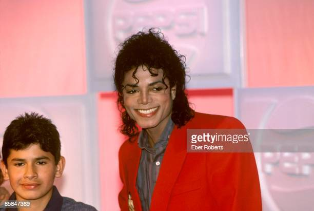 UNITED STATES MARCH 01 Michael JACKSON Michael Jackson with a child at a Pepsi photocall