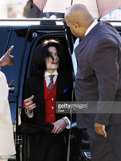 Michael Jackson pauses in his vehicle to speak to a bodyguard as he arrives at the Santa Barbara County courthouse for another day in his child...
