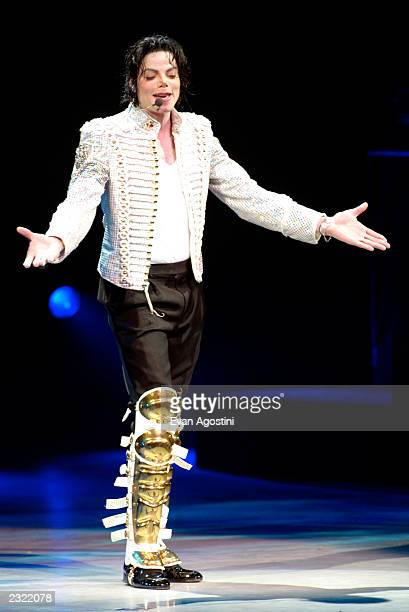 Michael Jackson performing at the Democratic National Committee's A Night at the Apollo voter registration drive fundraiser at The Apollo Theater in...