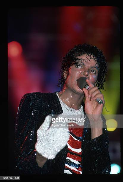 Michael Jackson performing He is shown waistup wearing his white sequined glove Photograph 1984