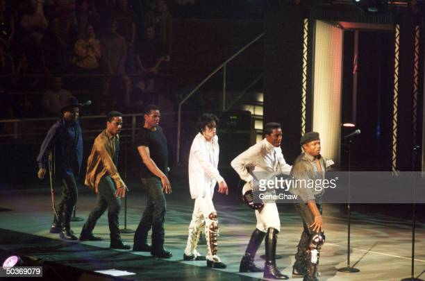 Michael Jackson performing with siblings formerly known asThe Jackson 5 at Michael Jackson's 30th anniversary concert