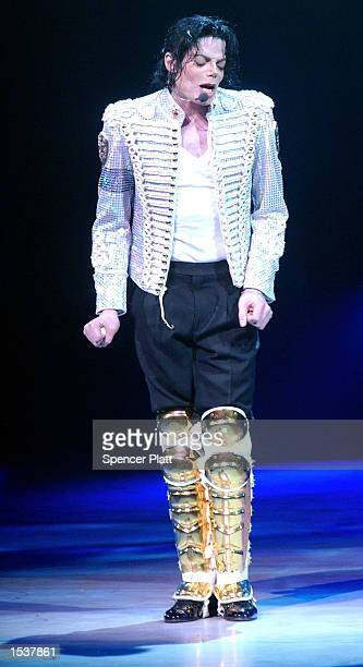 Michael Jackson performs April 24 2002 at a Democratic National Committee fundraiser at the Apollo Theatre in New York City The fundraiser is a...