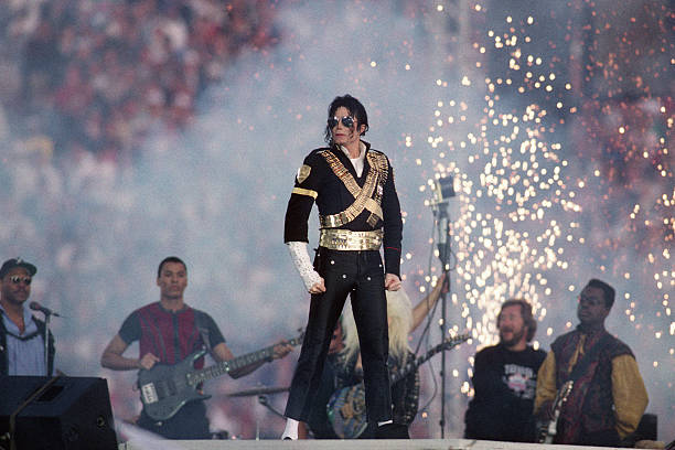 Michael Jackson performs during halftime of a 52-17 Dallas Cowboys win over the Buffalo Bills in Super Bowl XXVII on January 31, 1993 at the Rose...