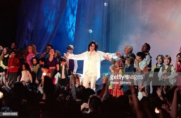 Michael Jackson performs on stage with children at the Brit Awards at Earls Court on February 19th 1996 in London