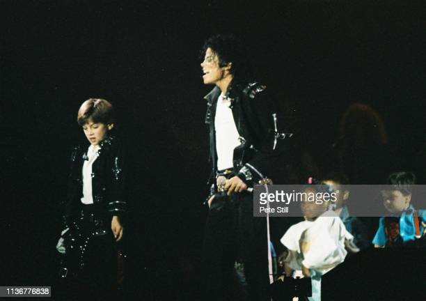 Michael Jackson performs on stage with children on his BAD tour at Wembley Stadium on 23rd July 1988 in London United Kingdom
