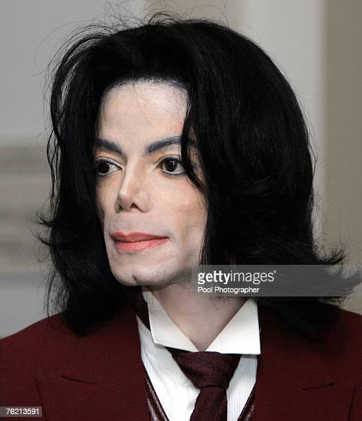 Michael Jackson reenters the courtroom during a break at the Santa Barbara County courthouse April 27 in Santa Maria California at his child...