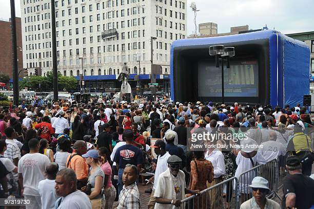Michael Jackson Remembered in Harlem by his many fans who laughed and cried while watching his funeral service on big screen TV front of State Office...