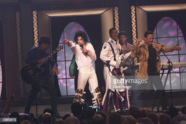 Michael Jackson sings with his brothers at the Michael Jackson 30th Anniversary Celebration The Solo Years at Madison Square Garden in New York City...