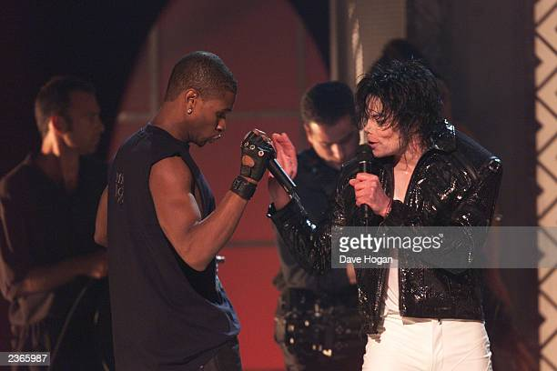 Michael Jackson sings with usher at the Michael Jackson 30th Anniversary Celebration The Solo Years at Madison Square Garden in New York City on...