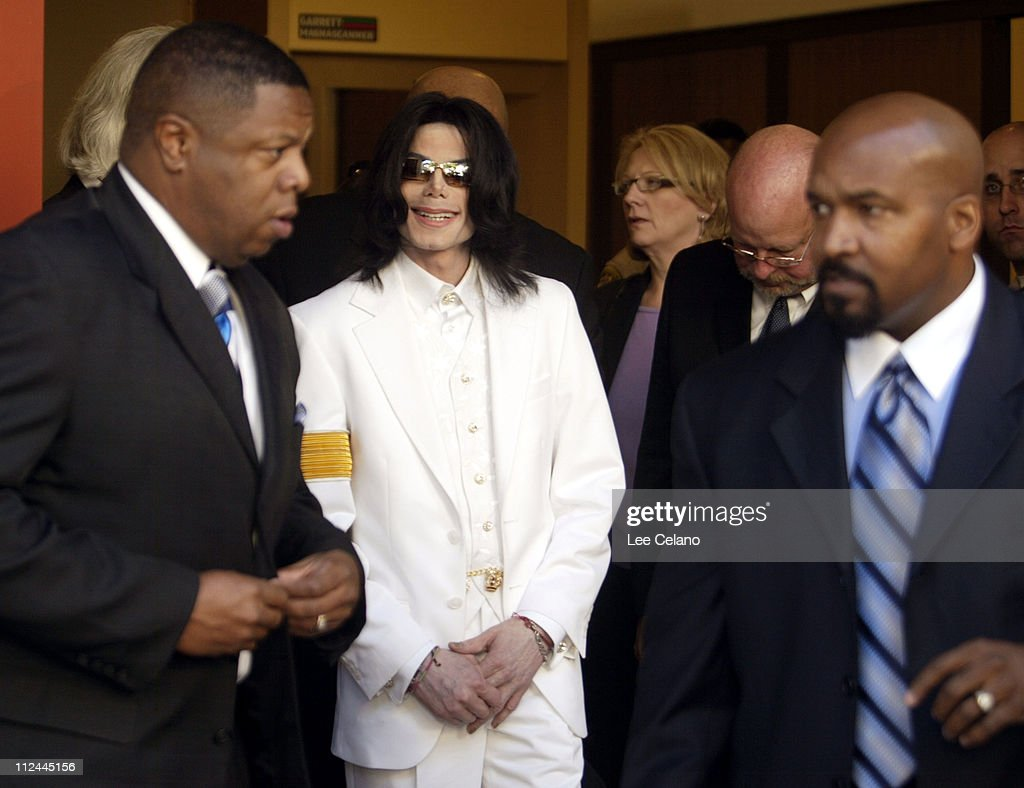 Michael Jackson smiles as he prepares to leave the Santa Barbara County Courthouse for lunch break in Santa Maria January 31, 2005. Jury selection is expected to take a month for the long awaited trial. Pool photo by: Lee Celano
