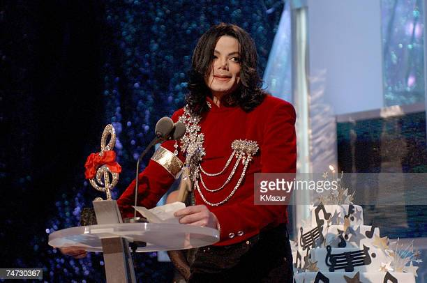 Michael Jackson speaks after Britney Spears presented Michael with a birthday cake at the 2002 MTV Video Music Awards at the Radio City Music Hall in...