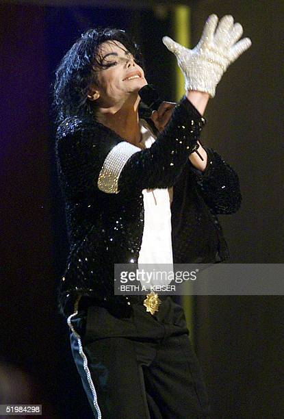 Michael Jackson sports a white glove during his first concert in eleven years at Madison Square Garden in New York 07 September 2001 It was the first...