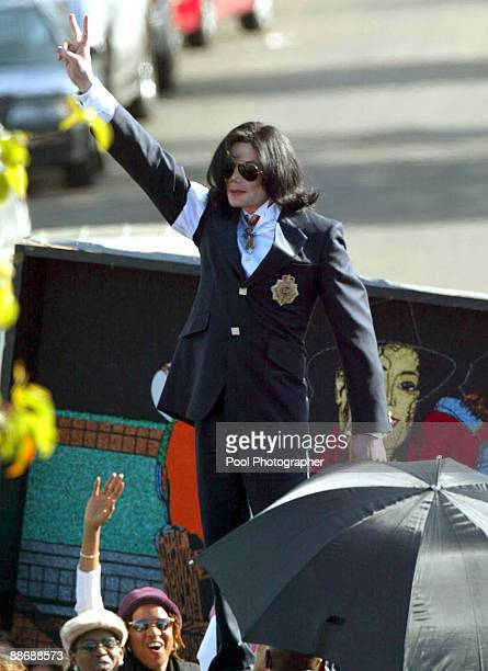 Michael Jackson stands on top of his SUV as he acknowledges hundreds of fans gathered outside the Santa Maria Courthouse