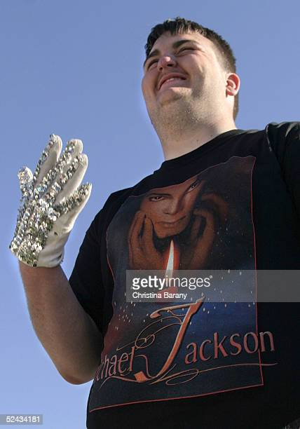 Michael Jackson supporter BJ Hickman of Knoxville Tennessee wears a white glove as he waits outside the Santa Barbara County Courthouse during...