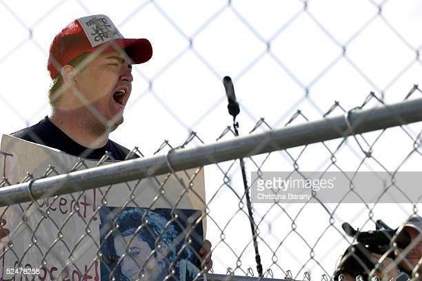 Michael Jackson supporter BJ Hickman yells Diane Diamond is a liar while a Court TV crew films outside before Jackson's arrival at the Santa Barbara...