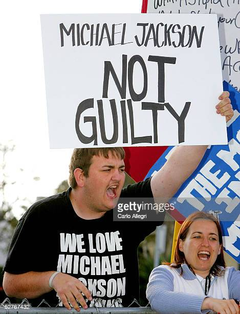 Michael Jackson supporter BJ Hickman yells with a sign as Jackson arrives at the Santa Barbara County Courthouse for the second day of the defense's...