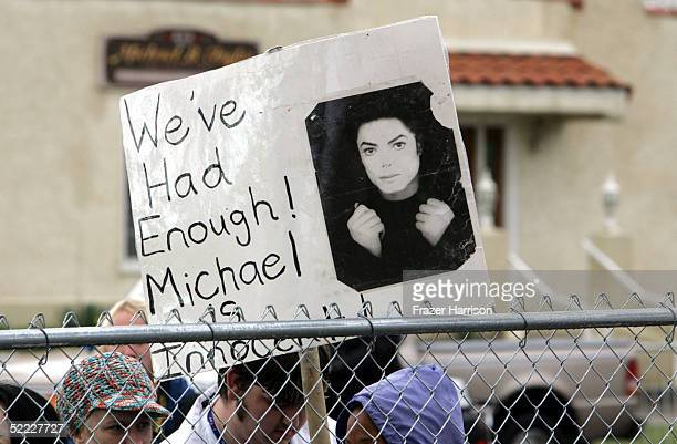 Michael Jackson supporter displays a sign outside the Santa Barbara County Courthouse as the jury selection phase of his child molestation trial...