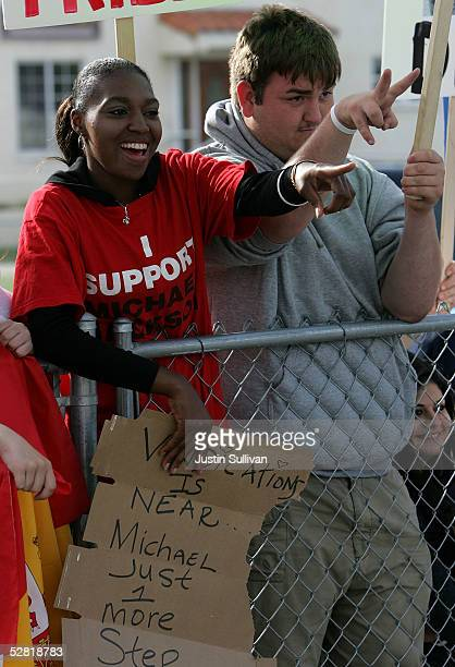 Michael Jackson supporters Susie Mumpfield and BJ Hickman wave to Jackson as he arrives at the Santa Barbara County Courthouse for another day of...