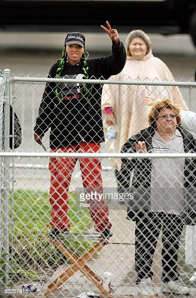 Michael Jackson supporters wait in the rain to see the singer as he arrives at the Santa Barbara County Courthouse for jury selection in his child...