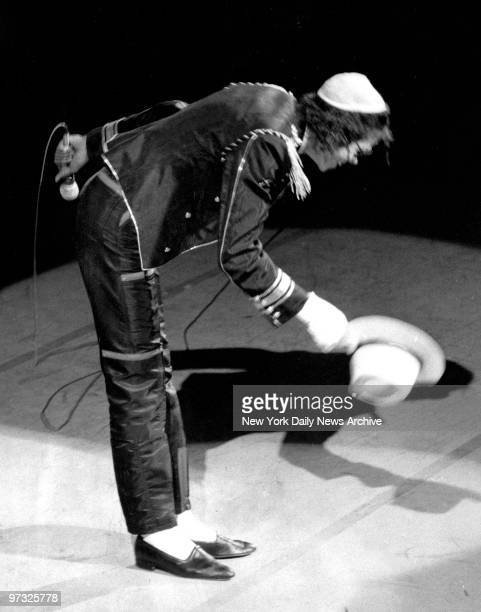Michael Jackson takes his hat off the Pepsi crowd at the New York State Theater He burned his head while making a Pepsi commercial