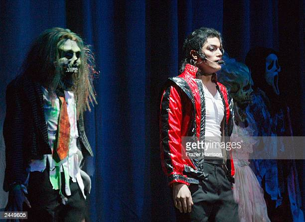 A Michael Jackson tribute artist performs 'Thriller' on stage at Michael Jackson's 45th birthday party tribute concert held at the Orpheum Theatre on...