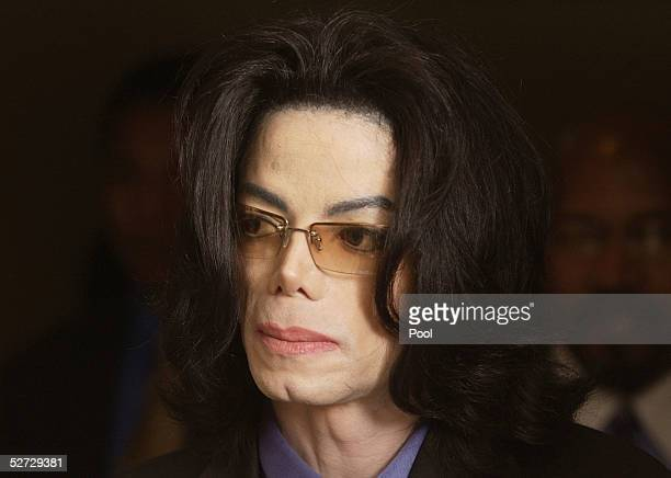 Michael Jackson walks out of the courtroom during his child molestation trial at the Santa Barbara County courthouse April 28, 2005 in Santa Maria,...