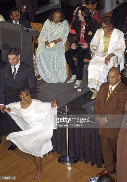 Michael Jackson watches dancers at the Ethiopian Embassy on April 1 2004 in Washington DC before receiving the Humanitarian Award from the African...