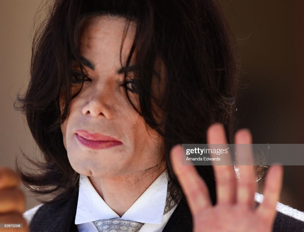 Michael Jackson waves as he departs the Santa Barbara County Courthouse following defense testimony in his child molestation trial May 23, 2005 in Santa Maria, California. Jackson is charged in a 10-count indictment that included molesting a boy, plying him with liquor and conspiring to commit child abduction, false imprisonment and extortion. He has pleaded innocent.