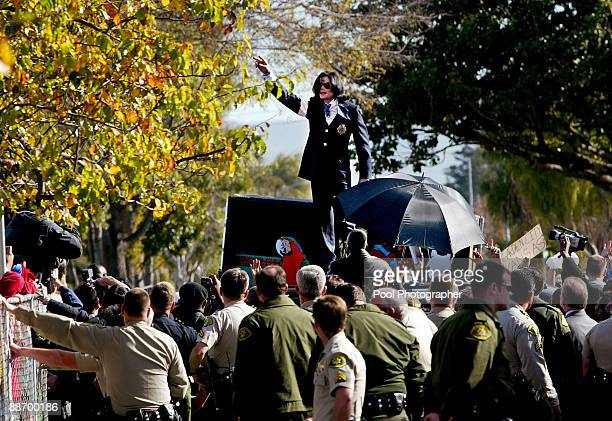 Michael Jackson waves at his fans standing on top of his limousine following his arraignment on sexual molestation charges in Santa Maria Court...