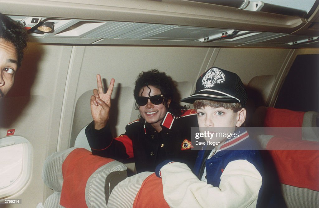 Michael Jackson with 10 year old Jimmy Safechuck on the tour plane... : News Photo
