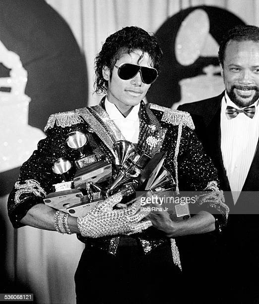 Michael Jackson with armload of Grammy Awards he won at the 26th Annual Grammy Awards February 28 1984 at the Shrine Auditorium in Los Angeles...
