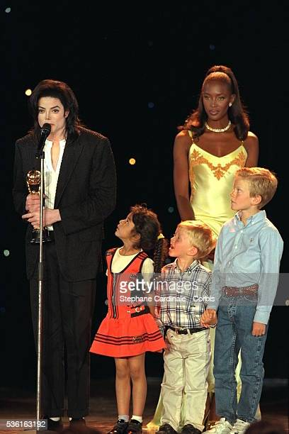 Michael Jackson with children and model Naomi Campbell on stage